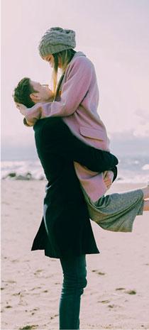man lifting a woman
