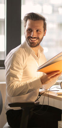 man holding a book smiling